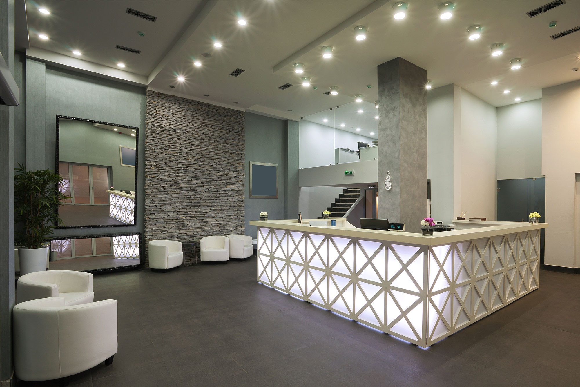 modern front desk office reception, bright and clean showcasing Office Cleaning Services